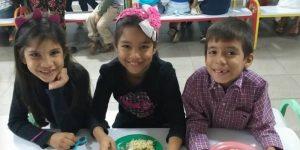 Venezuela kids with plates full of food